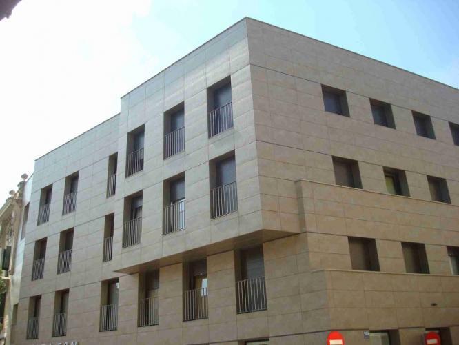 Edificio Viviendas Igualada con sistema de fachada ventilada · Sistema Masa