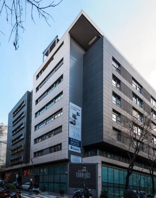 Mercado Torrijos con sistema de fachada ventilada · Sistema Masa