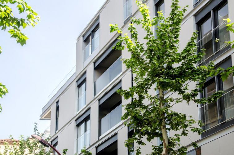 Edificio plurifamiliar Rambla fachadas ventiladas · Sistema Masa