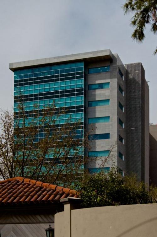 Edificio con revestimiento de fachadas - Sistema Masa