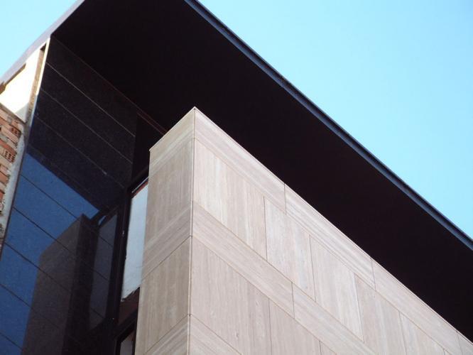 Muebles Juan Aguilar con sistema de fachada ventilada · Sistema Masa