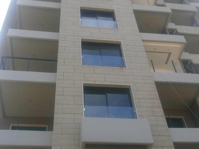 Victoria Residence Aramoun con fachadas ventiladas de Sistema Masa