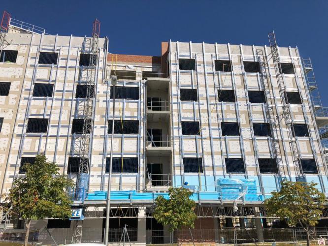 100 viviendas Barajas con fachadas ventiladas sistema masa